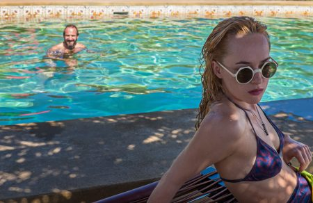"""Ralph Fiennes as """"Harry Hawkes"""" and Dakota Johnson as """"Penelope Lanier"""" in A BIGGER SPLASH. Photo courtesy of Fox Searchlight Pictures. © 2015 Twentieth Century Fox Film Corporation All Rights Reserved"""